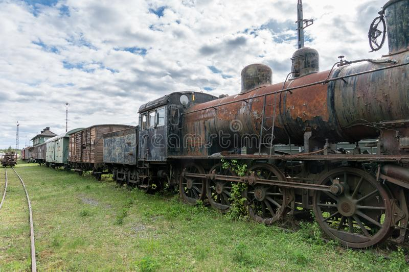 Old abandoned steam locomotive with train set royalty free stock photos