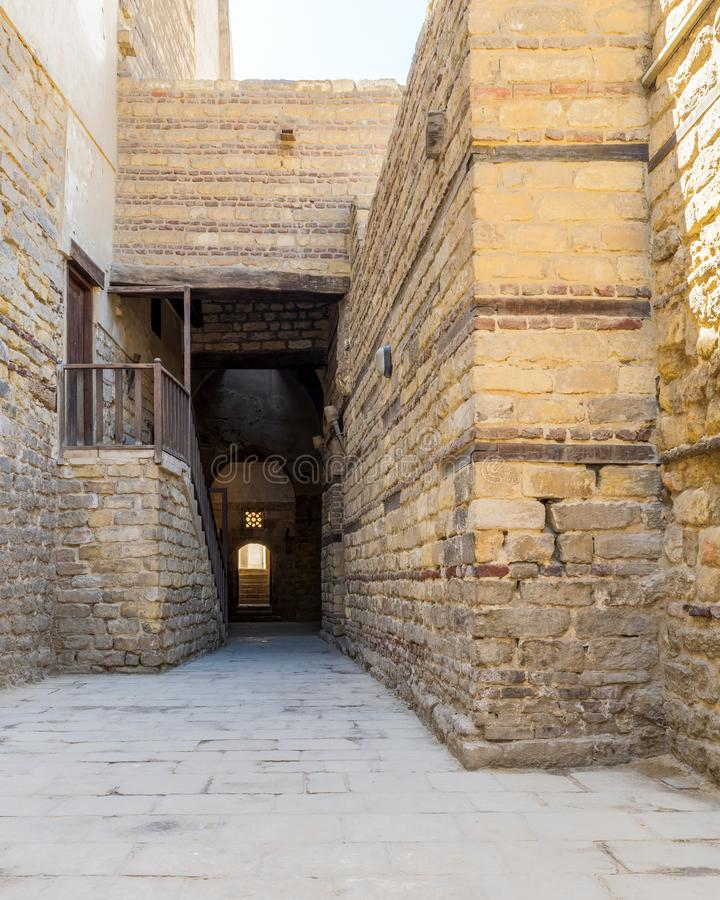 Old abandoned stone bricks passage surrounding Sultan Qalawun Complex, Cairo, Egypt. Exterior daylight shot of old abandoned stone bricks passage surrounding royalty free stock photo