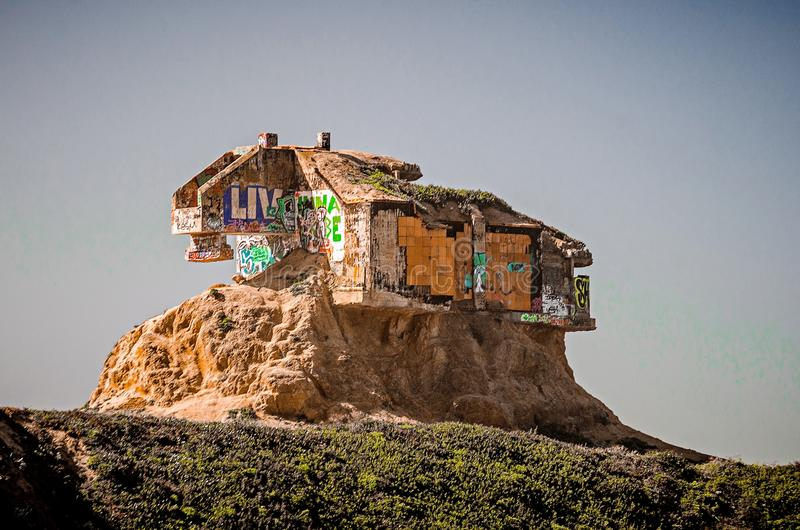 old abandoned structure on devils slide cliffs on pacific ocean stock photo