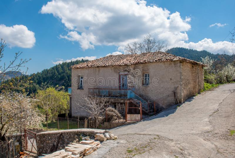 Old abandoned traditional stone house on mountain village named royalty free stock image