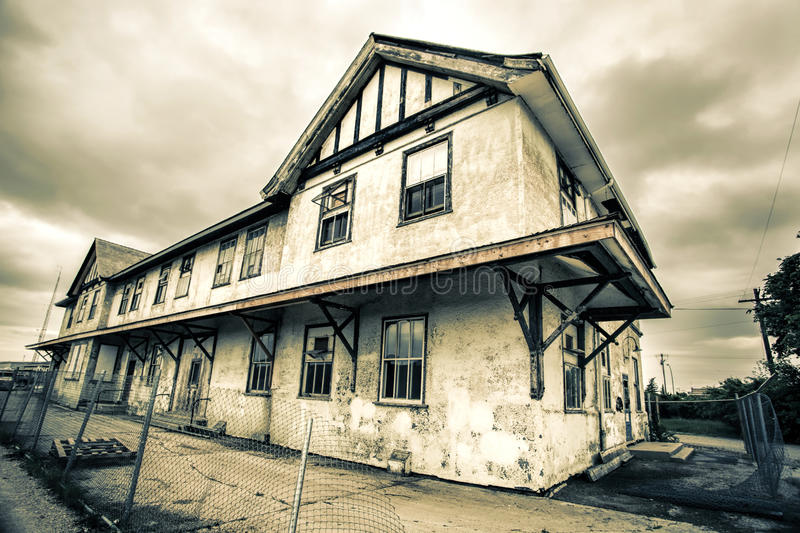 Old Abandoned Train Station. An old abandoned train station. Image styled with an old grungy effect to give the building a darker look stock image
