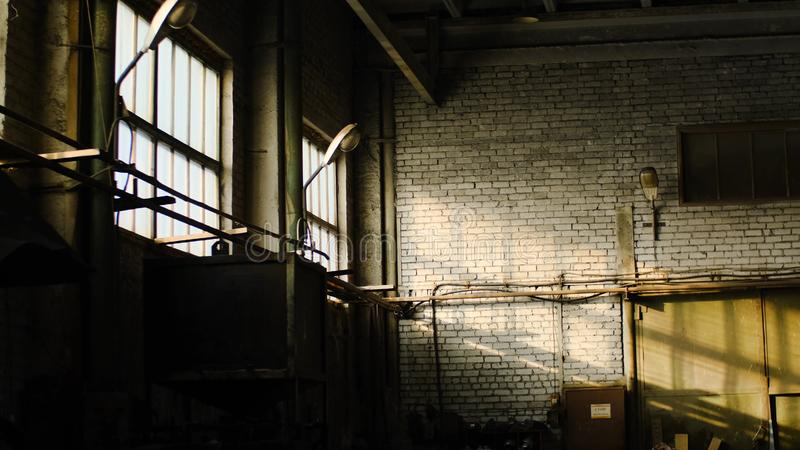 Old abandoned warehouse of industrial enterprise. Stock footage. Small abandoned room of old warehouse cluttered and royalty free stock image