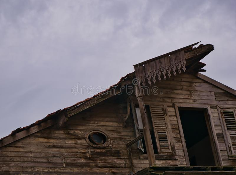 Old abandoned wooden house with missing balcony royalty free stock images