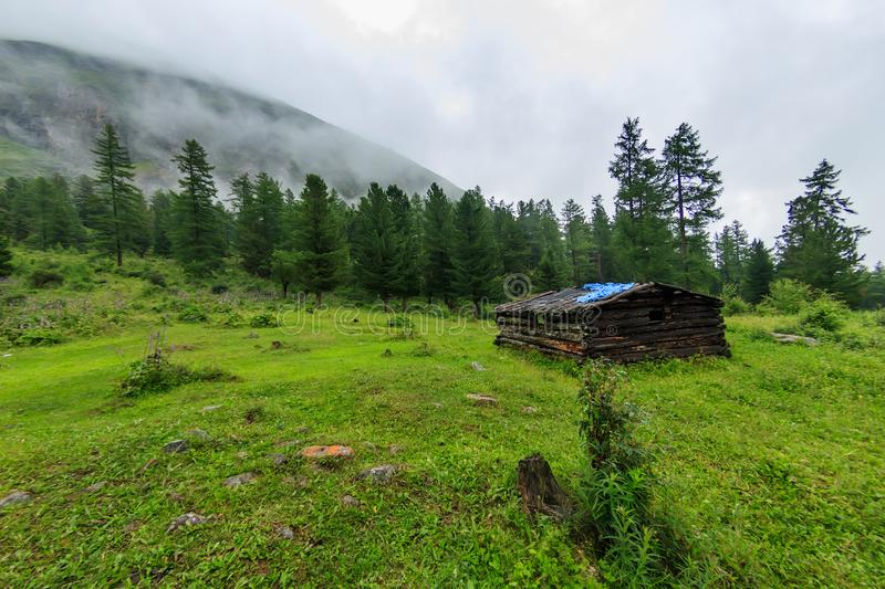 Old abandoned wooden house stands in the summer in the mountains of cloud stock photos