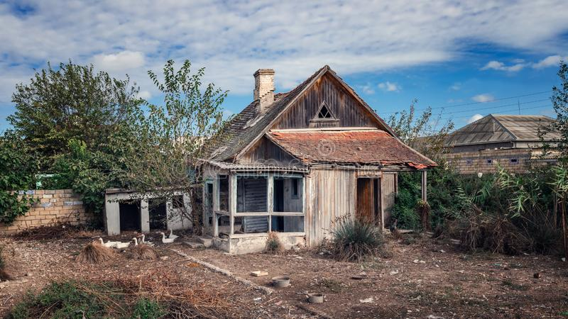 Old abandoned wooden rural house and yard. Old abandoned wooden rural house and back yard royalty free stock photography