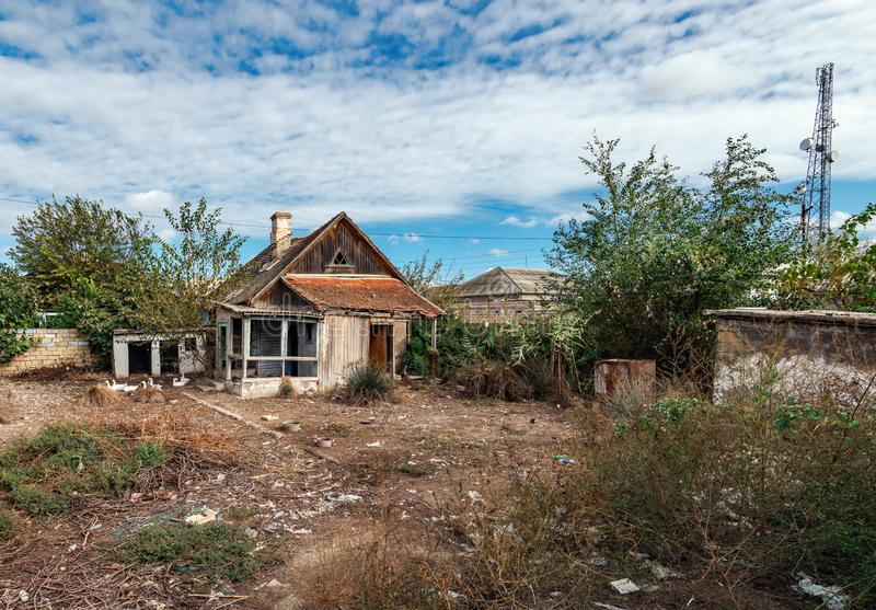 Old abandoned wooden rural house and yard. Old abandoned wooden rural house and back yard stock photo