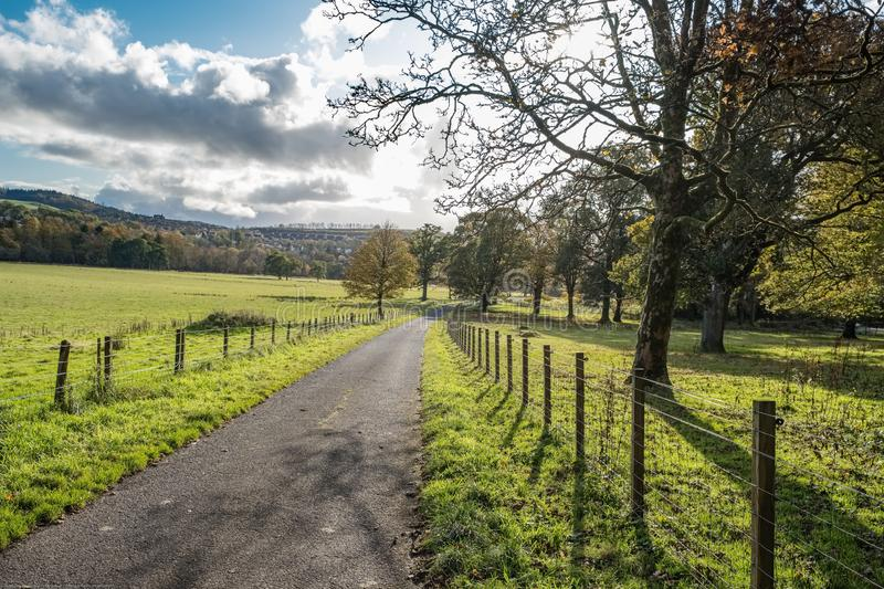 The old access road to Ardgowan Estates in Inverkip at Autumn royalty free stock photos