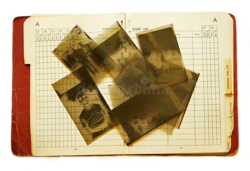 Old Address Book and Negatives. This is an old address/notebook with negatives on it. It's turned to a page for a Christmas list dated 19____'s royalty free stock photo