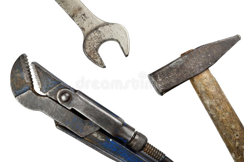 Old adjustable spanner, hammer and wrench. Tools old set of wrench, adjustable spanner and hammer isolated on white background royalty free stock photo