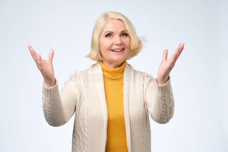 Old adult blonde excited cheerful astonished lady smiling, laughing stock photos
