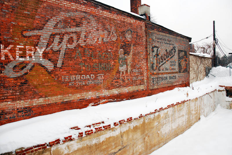 Old advertisements. Demolition of several buildings for new construction revealed a century old advertisement in Bloomfield NJ stock images