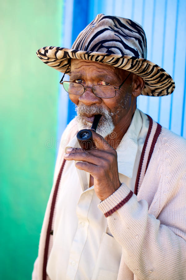 Download Old african male smoking stock photo. Image of portrait - 14081574