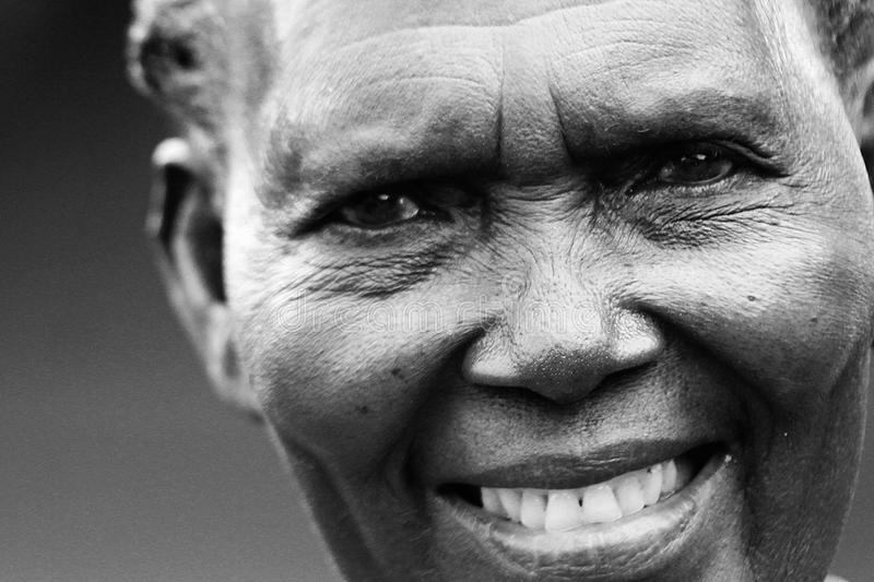 A old African woman smiles with a full set of teeth royalty free stock images
