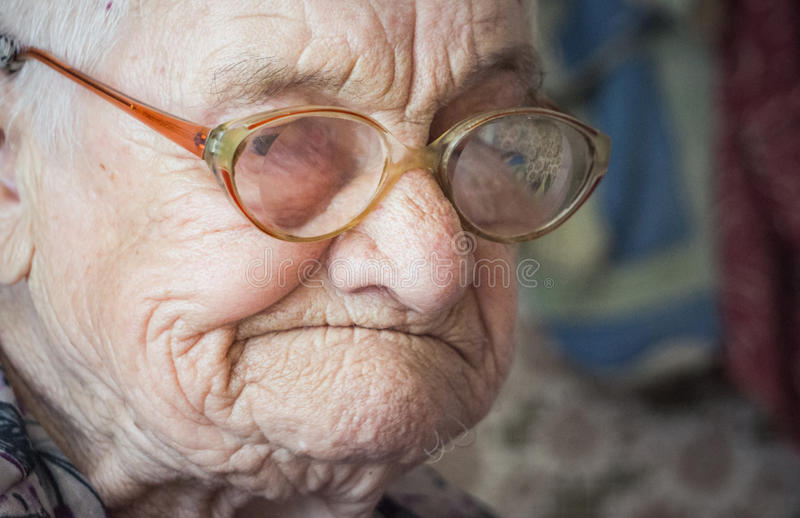 Old age and sadness. Portrait of an elderly woman royalty free stock images