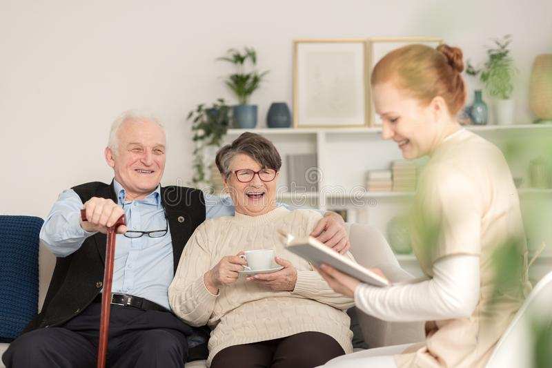 Old age tender couple laughing royalty free stock images