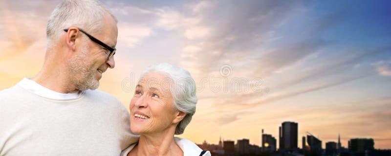 Senior couple hugging over evening tallinn city royalty free stock photography