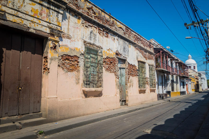 Old aged houses, Santa Marta, caribbean city in. Old and damaged houses in Santa Marta, popular caribbean destination in northern Colombia royalty free stock photo
