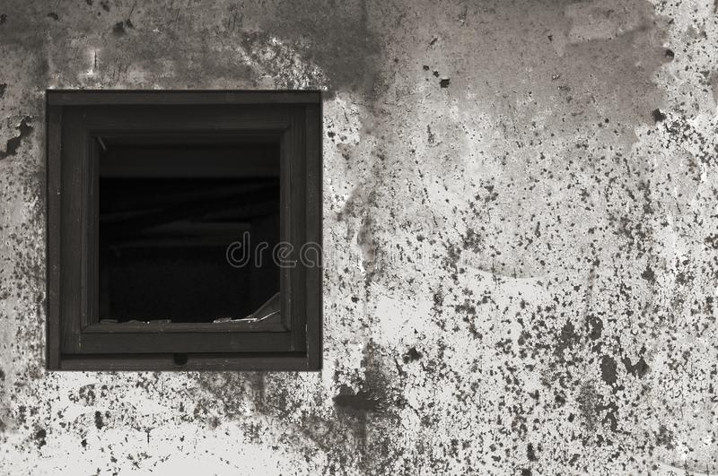 Old aged rusted grey black white shack hut wall paint, broken window glass wooden frame, weathered grungy rusty steel dirty gray. Painted metallic texture royalty free stock photo
