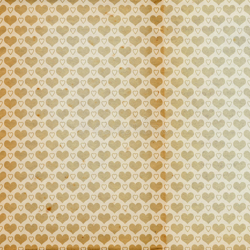 Old aged vintage antique paper with heart pattern royalty free stock photos