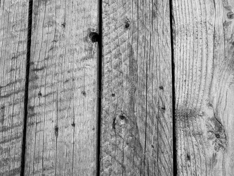 Old, aged wood table close up shot in black and white royalty free stock images