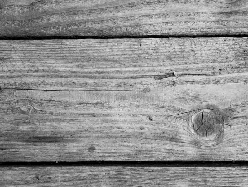 Old, aged wood table close up shot in black and white royalty free stock photo