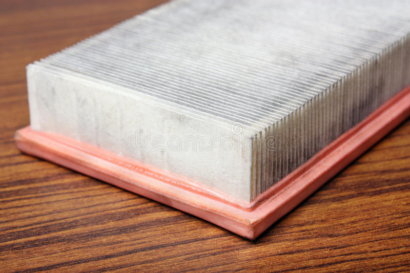 Old air filter. In the table stock photography