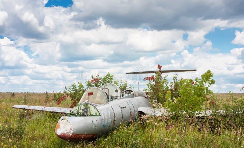 Old aircraft in elderberry bush, Aero L-29 Delfin Maya czechoslovakian military jet trainer royalty free stock photography