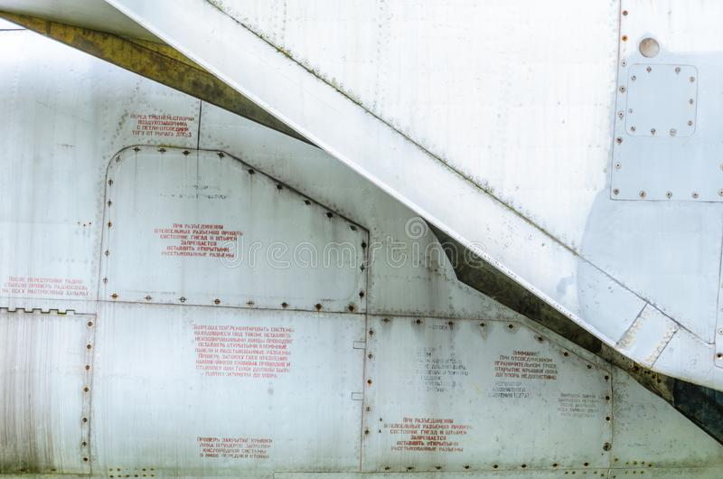 Old aircraft fuselage close up. Door handle and rivets royalty free stock images
