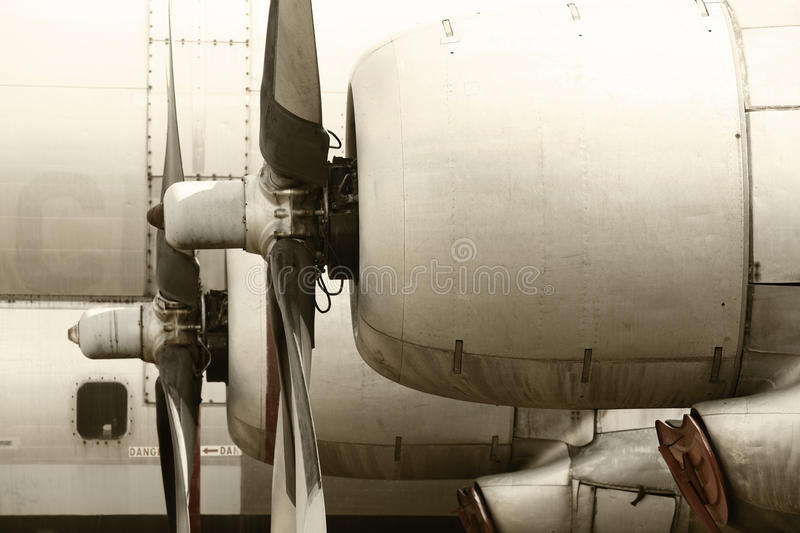 Old aircraft propeller engines airframe and blades in warm tone. Horizontal stock photos