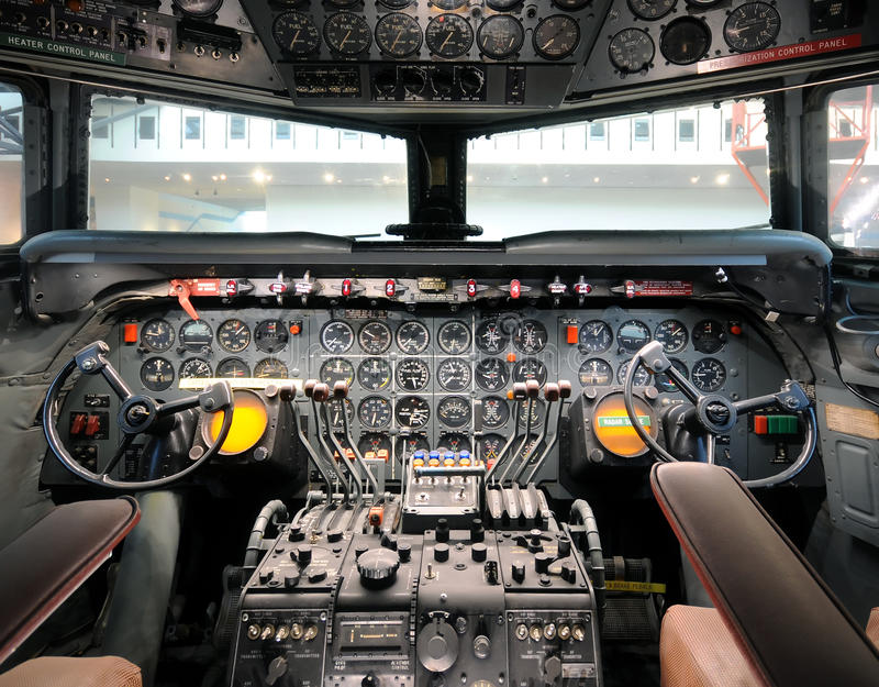 Old airplane cockpit. Cockpit view of classic 1950s airliner stock photo