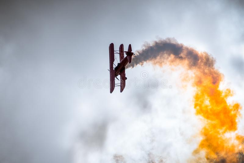 Old airplane performing flying tricks royalty free stock photography