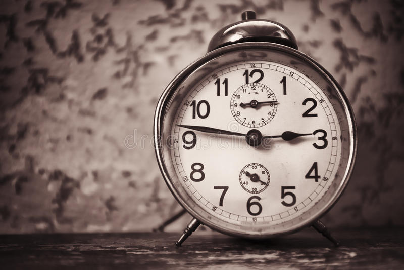Old alarm clock. At a bedroom stock photos
