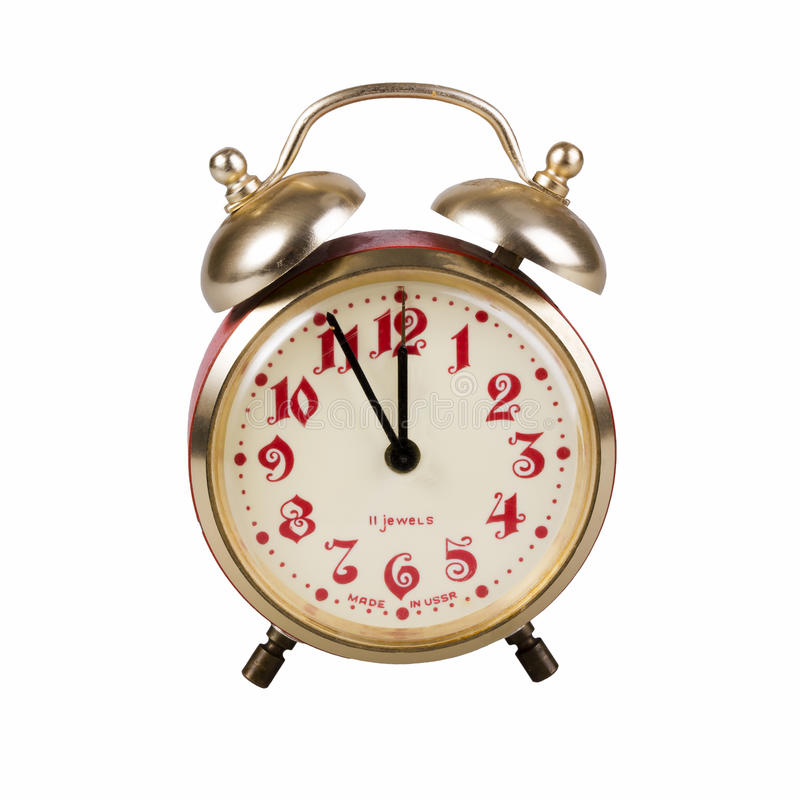 Old alarm clock. Old red alarm clock on a white background royalty free stock photos