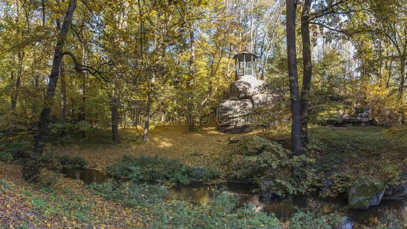 Old Alcove in Sofiyivka Park in Uman, Ukraine. Uman, Ukraine - 10.13.2018. Beautiful autumn trees around the old alcove in Sofiyivka park, Ukraine stock images