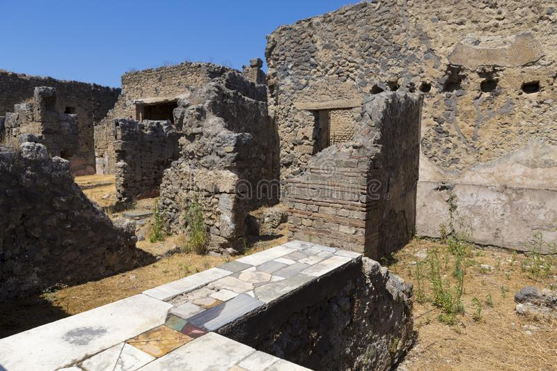 Old alley and houses from Pompeii city. Italy royalty free stock image