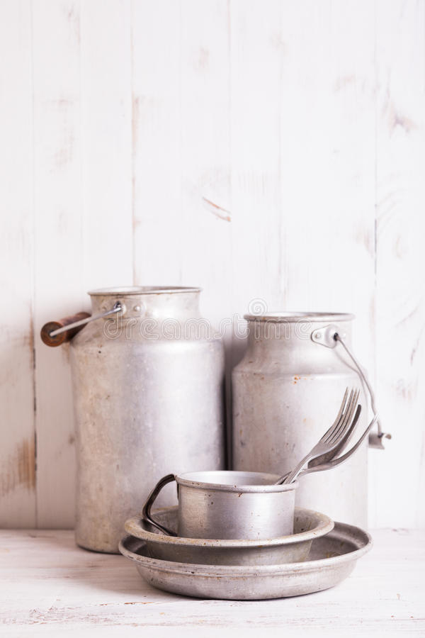 Old aluminium utensils. On the shabby chic kitchen royalty free stock photos