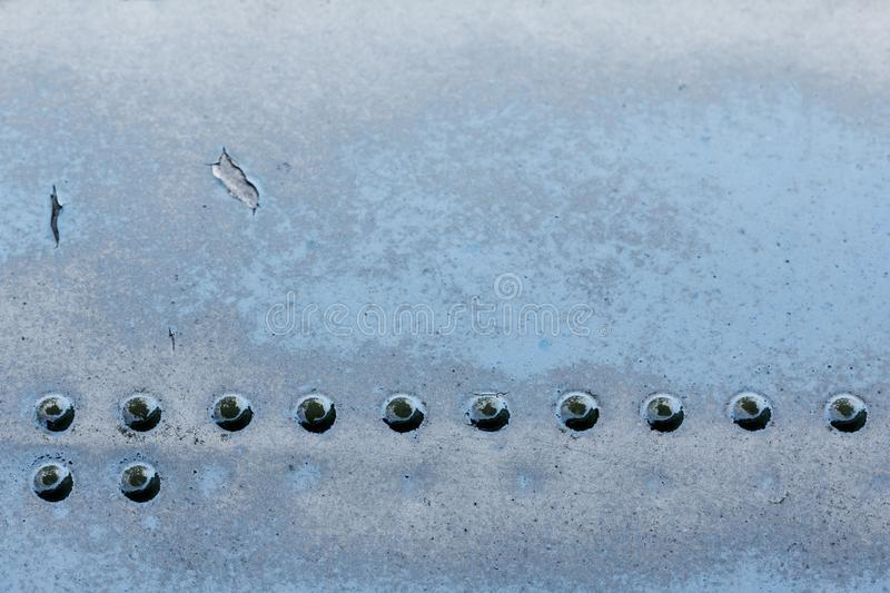 Old aluminum background detail of a military aircraft, surface corrosion. royalty free stock images