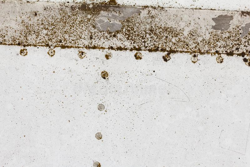 Old aluminum background detail of a military aircraft, surface corrosion. Oxidized metal texture with rivets stock photography