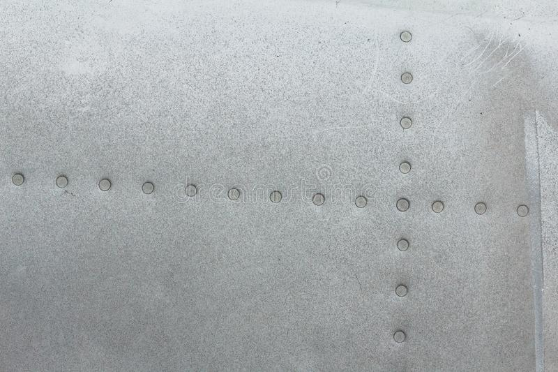 Old aluminum background detail of a military aircraft, surface corrosion. royalty free stock photography