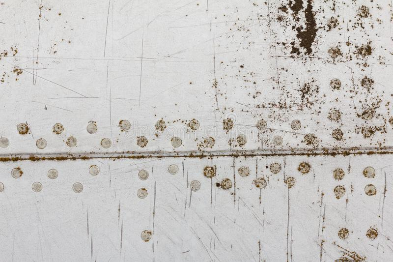 Old aluminum background detail of a military aircraft, surface corrosion. stock images