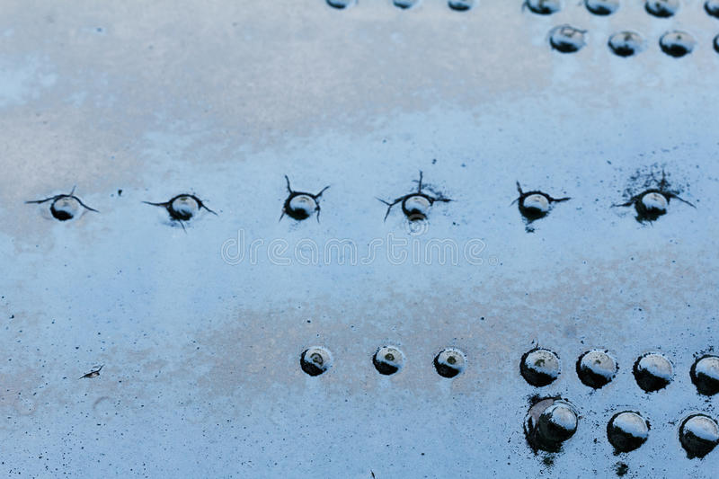 Old aluminum background detail of a military aircraft, surface corrosion. Oxidized metal texture with rivets royalty free stock images