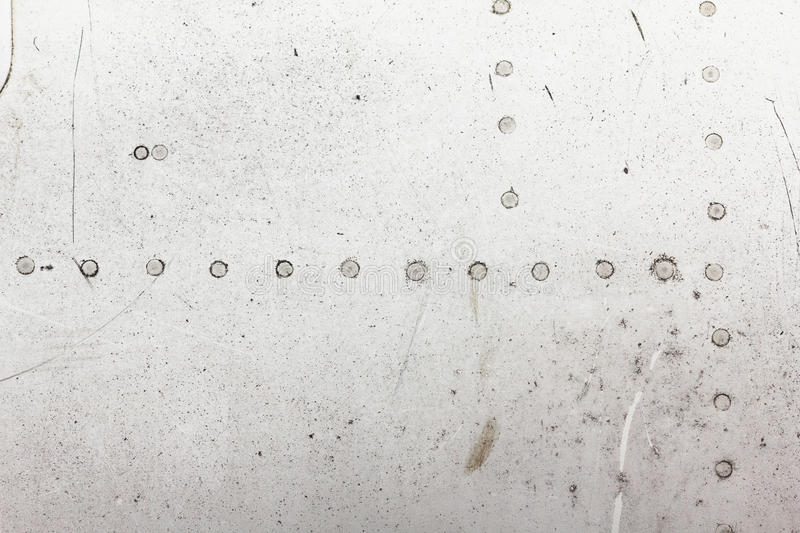 Old aluminum background detail of a military aircraft, surface corrosion. Oxidized metal texture with rivets royalty free stock image