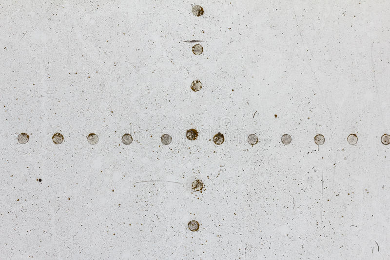 Old aluminum background detail of a military aircraft, surface corrosion. Oxidized metal texture with rivets royalty free stock photography