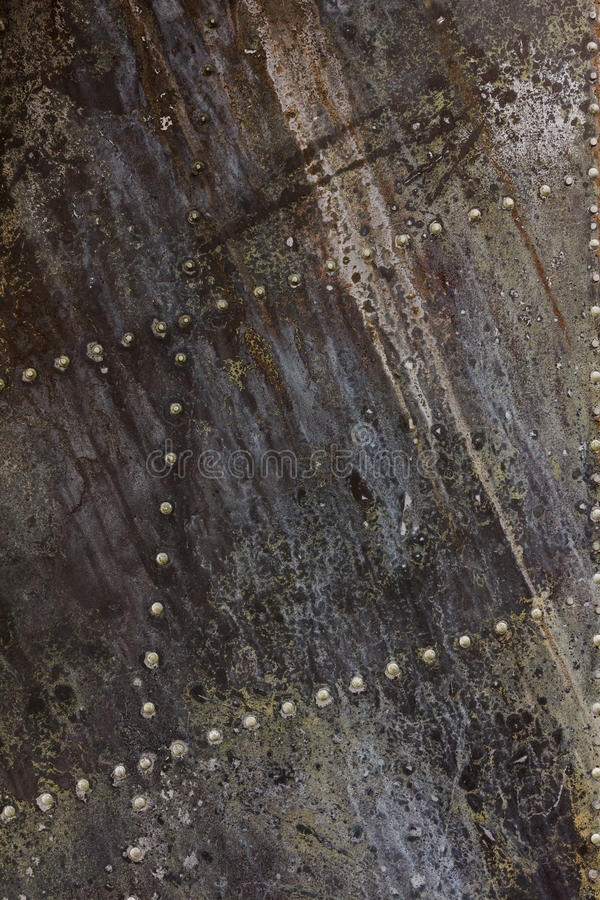 Old aluminum background detail of a military aircraft, surface corrosion. Oxidized metal texture with rivets royalty free stock photos