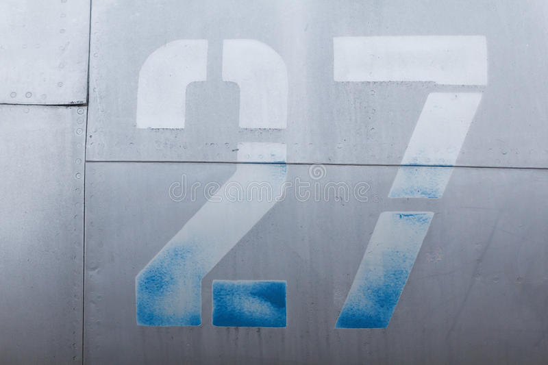 Old aluminum background detail of a military aircraft, surface corrosion. Oxidized metal texture with rivets stock photo