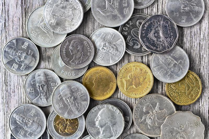 Old America dollar coin, euro coin, one pound coin and Thai baht on the wood table. The concept of the main currency exchange can royalty free stock photography