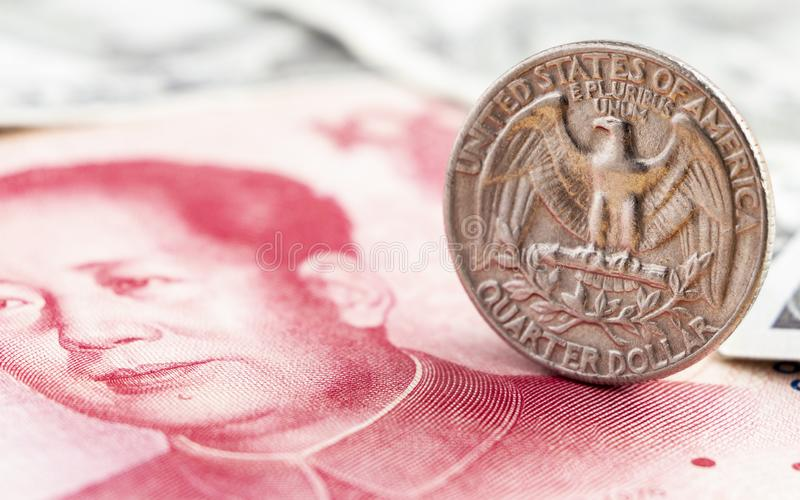 Old America quarter dollar coin on China yuan bills banknote. Th. E concept of the main currency exchange can be used worldwide stock photo