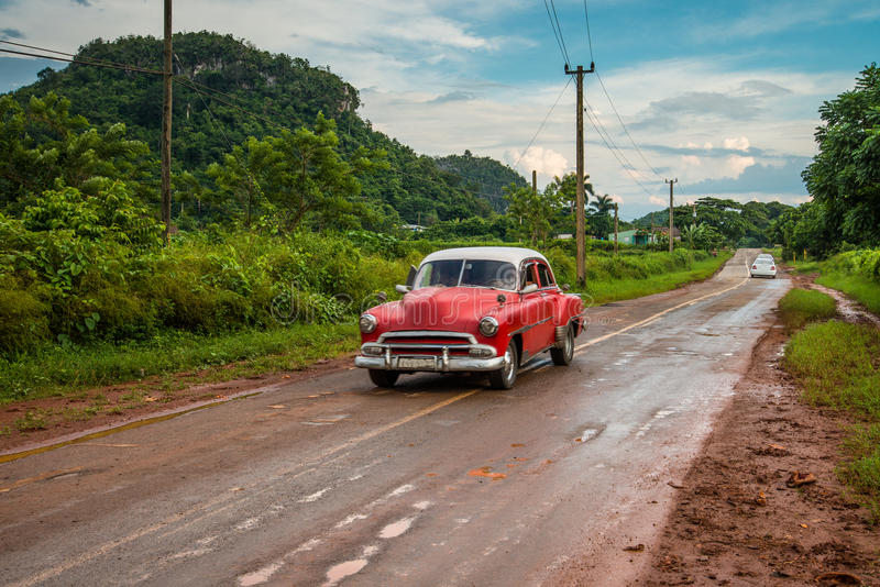 Old american car drive on rural road royalty free stock image