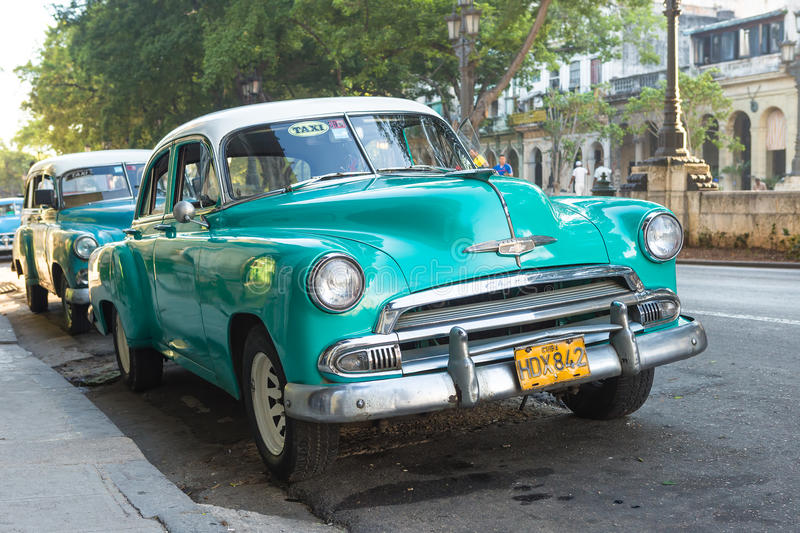 Old american car in a famous street in Havana. Vintage Chevrolet parked near El Prado street in Havana.These old classic cars,mostly u sed as private taxis,have royalty free stock photo