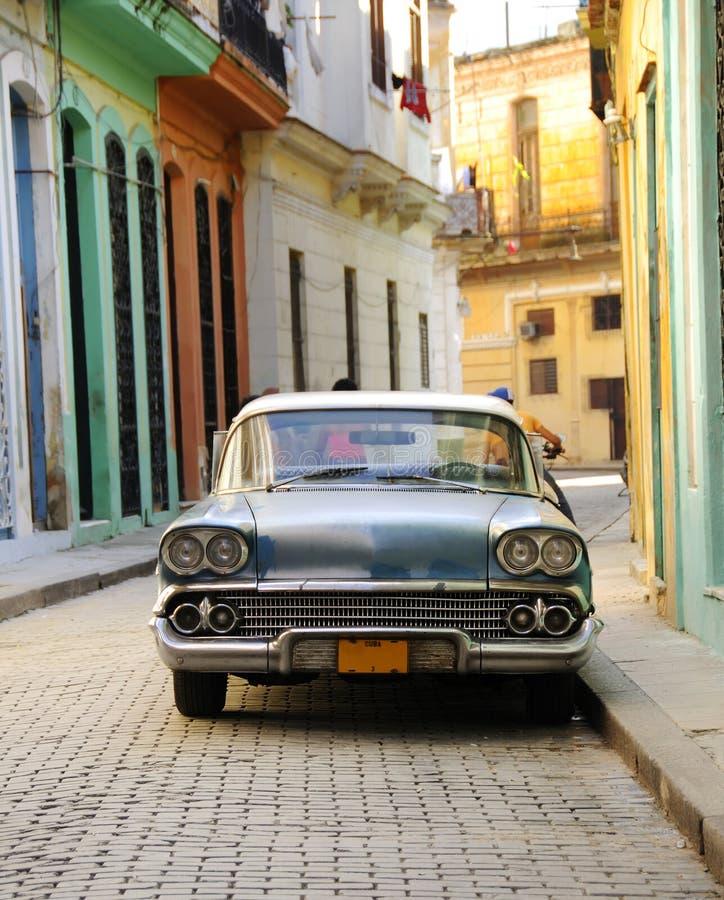 Old american car parked in Havana street. Vintage classic american car parked in colorful havana street facades stock photo